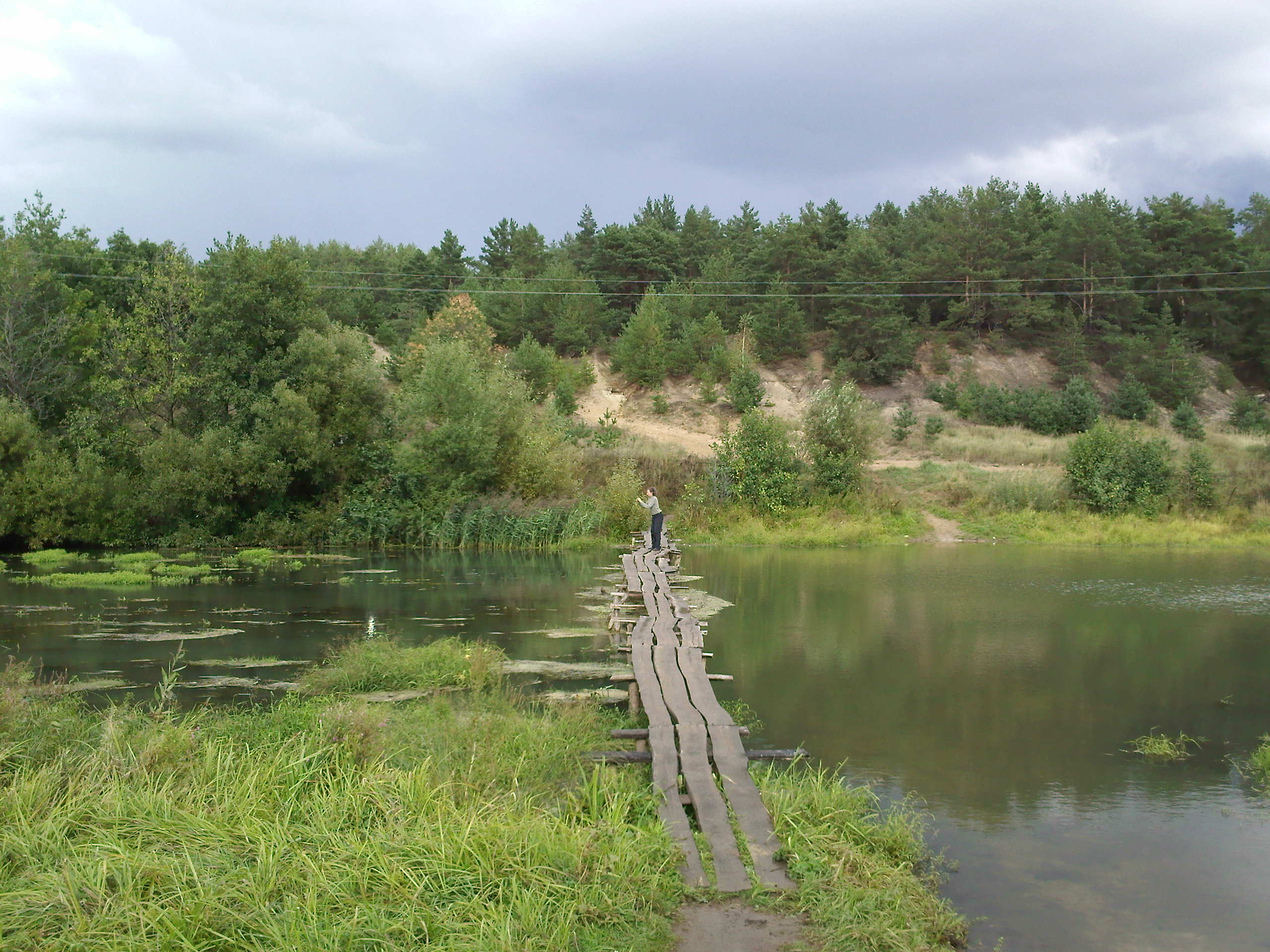 Russian Village: On the wooden bridge